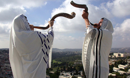with blowing of the shofar a ram s horn to commemorate the creation of
